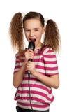 Fille avec le microphone image libre de droits
