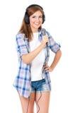 Fille avec le microphone et les écouteurs photo stock