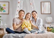 Fille avec le père et la mère Photo stock