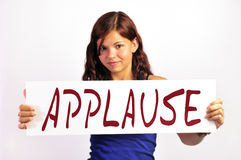Fille avec le panneau d'applaudissements Photographie stock
