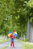 Fille avec le parapluie image stock