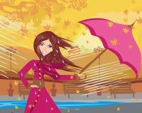 Fille avec le parapluie un jour pluvieux d'automne Photographie stock