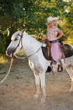 Fille avec le poney d'animal familier. Photos stock