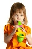 Fille avec le saxophone de jouet Photo stock