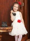 Fille avec le téléphone de vintage Images stock