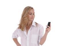 Fille avec le téléphone portable Photographie stock