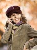 Fille avec le téléphone portable Image libre de droits