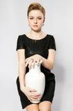 Fille avec le vase Photo libre de droits