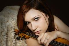Fille avec le violon Photographie stock