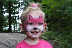 Fille avec le visage peint Photos stock