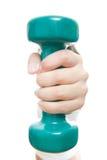 Fille avec les haltères vertes à disposition Image stock