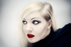 Fille avec les languettes rouges Photographie stock libre de droits
