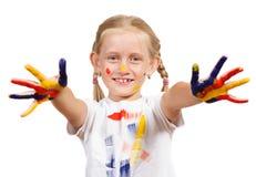 Fille avec les mains peintes Photographie stock libre de droits