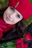 Fille avec les roses rouges Photos stock