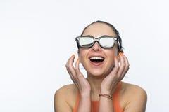 Fille avec les verres 3D Photos stock