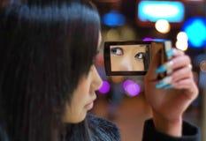 Fille avec peu de miroir Photos stock