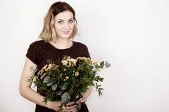 Fille avec un bouquet Images stock