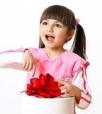 Fille avec un cadeau Photo stock