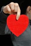 Fille avec un coeur rouge Image libre de droits