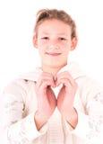Fille avec un coeur sur un blanc Photographie stock libre de droits