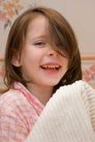 Fille avec un essuie-main Photographie stock libre de droits