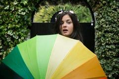 Fille avec un parapluie d'arc-en-ciel Photos libres de droits