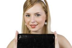 Fille avec un sac à main Image stock