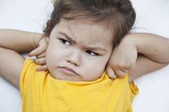Fille avec un visage malheureux Photos stock