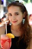 Fille avec une boisson Photo stock