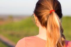 Fille avec une coiffure de queue de cheval pour des sports Images stock