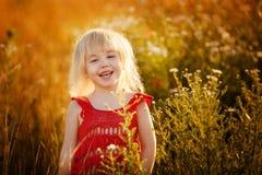 Fille blonde dans le domaine Photo libre de droits