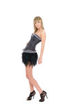 Fille blonde dans une jupe noire courte Image libre de droits