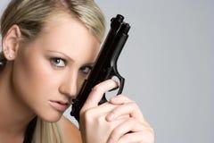 Fille blonde de canon photographie stock