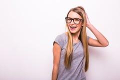 fille blonde en verres sur le fond blanc Photos libres de droits