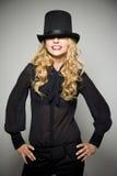 Fille blonde riante avec le premier chapeau Photos stock