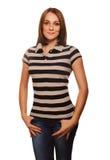Fille brune de cheveux de femme dans le gilet et des jeans rayés image libre de droits