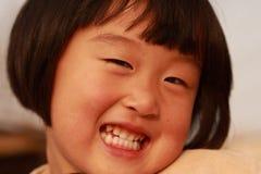 Fille chinoise heureuse Image libre de droits