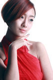 Fille chinoise portant une robe rouge Photo stock