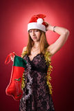 Fille déçue avec le bas de Noël Images stock