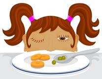 Fille décidant si elle mange ses légumes Image stock