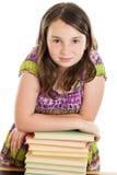 Fille d'école avec la pile de livres Photographie stock