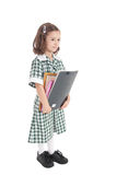Fille d'école dans l'uniforme avec des livres Photos stock