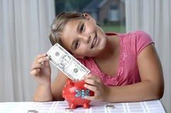 Fille d'école et billets d'un dollar Photographie stock