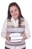 Fille d'école tenant des livres Photos stock