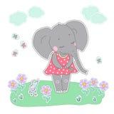 Fille d'éléphant avec les yeux fermés ayant la fleur dans sa main Images stock