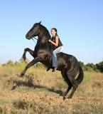 Fille d'équitation Photos libres de droits