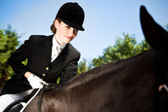 Fille d'équitation de Horseback Photographie stock libre de droits
