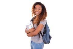 Fille d'étudiant d'afro-américain tenant des livres - personnes de race noire Images stock