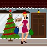 Fille d'achats de Noël Images stock
