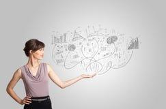 Fille d'affaires présent les graphiques et les diagrammes tirés par la main de croquis Images stock